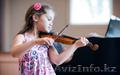 Игра на скрипке.